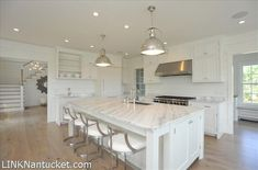 white kitchen with natural floor