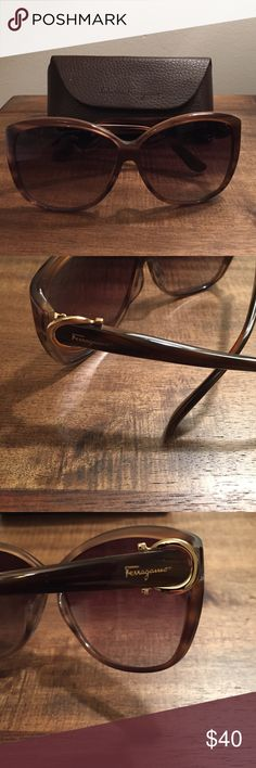 Women's Salvatore Ferragamo sunglasses Women's Salvatore Ferragamo sunglasses in Havana/gold with original case. Style #SF610s. Hair- like scratch on right side, middle of lens and left side bottom left corner. Salvatore Ferragamo Accessories Sunglasses