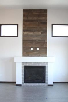 board and batten fireplace wall with wood shelf Reclaimed Wood Fireplace, Wood Fireplace Surrounds, Reclaimed Wood Paneling, Fireplace Wall, Commercial Kitchen Design, Empty Room, Board And Batten, Wood Shelves, Building A House