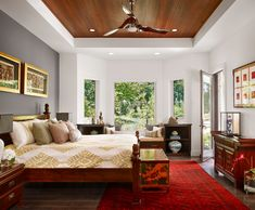 Bright minka fans in Bedroom Asian with Dark Ceiling next to Raised Ceiling alongside Soffit Lighting and Wood Ceiling