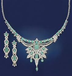 An emerald and diamond necklace and earpendants