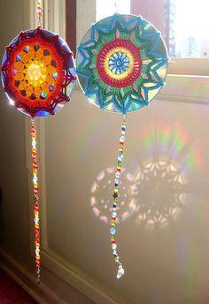 Crochet Mandala over a CD. Used as a suncatcher, the reflection shows the mandala's shape! How fun?!