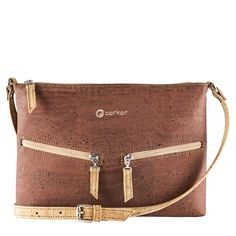 Travel Cross-Body Bag for Women - Front Pockets - Vegan Red Cork from Corkor. VEGAN BAG - PETA VEGAN APPROVED - No animal products used - Cool gift for any vegan or vegetarian. SPACIOUS INTERIOR - SOFT COTTON LINNING - This travel cross-body bag for women has one back-wall with 2 slip pocket and one zipper pocket. DURABLE MATERIAL - Sturdy and protective exterior with two outside pockets. MADE FROM CORK - Sustainable alternative to animal leather - MADE BY PORTUGUESE ARTISANS IN PORTUGAL…