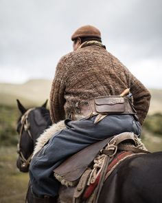 From our South America supplement back in October 2015, this is one of a series of photographs by #NGTUK's @helencathcart focusing on the gauchos of #Argentina. Here a gaucho sits atop his horse while his companions round up sheep ready for shearing #travelphotography #travelgram #instatravel