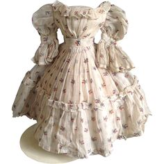 This is a really fabulous original 1860s lawn dress with delicate flower decoration in typical Enfantine style.  The dress is beautifully constructed