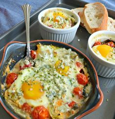 Artichoke & Spinach Blue Cheese Baked Eggs - a healthy recipe for breakfast, brunch or an easy dinner. This lightened egg recipe is so pretty and sunshine-y, a great way to start the day.