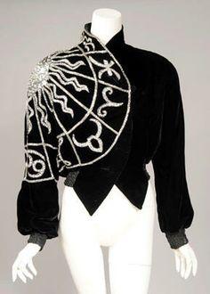 A Schiaparelli-inspired velvet 'Zodiac' jacket by Bob Mackie, with beaded zodiacal glyphs surrounding a sun symbol.