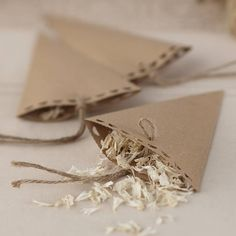 Image from http://cdn3.notonthehighstreet.com/system/product_images/images/001/441/050/original_vintage-style-wedding-confetti-cones.jpg.