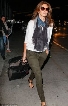 Plane gorgeous: The supermodel was dressed down in a comfortable ensemble but still looked chic