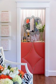 High Point Showhouse | Gray Walker Interiors #interiordesign #homedecor #livingroom #color #pink #coral #homebar