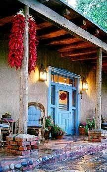 Wonderful example of New Mexico style buildings with colorful doors and beautiful hanging ristras. Via Meanwhile in New Mexico on Facebook