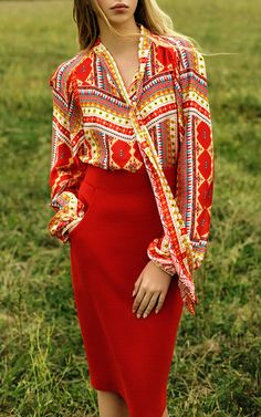 Rendered in silk, this **Yanina** blouse features an all over multicolor scarf print and a tie neck.
