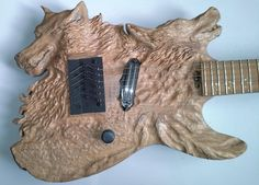 Wood carving - Wolf - hunting dog carved electric guitar - entalhe madeira Ton Dias luthier - Escultura,  40x10x100 cm ©2013 por Ton Dias -            wolf dog guitar wood carving sculpture entalhe madeira escultura woodcraft woodwork woodcarving ton dias escultor luthier