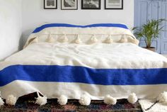 Colour: Mariner Blue on Off White  Give your home a chic bohemian touch with our luxurious Moroccan blankets/throws with over-sized pom poms on each