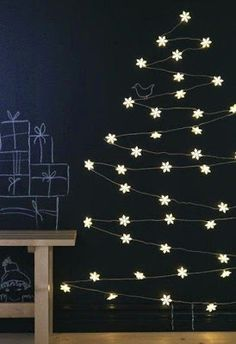 Chalkboard wall that is decorated to suit the season
