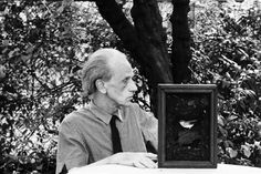 Joseph Cornell poses for a portrait in 1967 at his home and studio in Flushing, Queens, New York