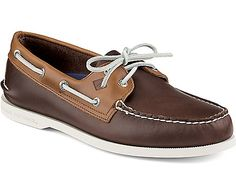 A classic pair of boat shoes has brown leather and a white sole with a slight herringbone pattern that it uses for grip. It looks great on summer sockless, altho it's utilized as a casual pair of shoes.