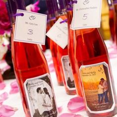 homemade wine for wedding favors doubles as seating cards
