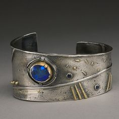 Wendy Thurlow- Fire wind Cuff- Sterling, 22k gold, sapphires and opal. || hammeredbywendy