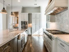 """5602 Sugar Hill Houston, TX 77056: Photo The dream Kitchen opens to the Family Room and features custom cabinets, a large central island topped with Super White Quartzite. Viking appliance package includes a 48"""" Gas Cooktop Convection Oven, Microwave, Dishwasher"""