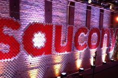 The event's centerpiece was a fence wall that spelled out the brand's name using Solo cups. The installation was meant...