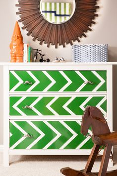 I love this green arrow dresser for a kids' bedroom!