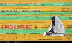 http://www.photaki.com/picture-indian-sitting-on-a-ghat-in-benares-india_380063.htm