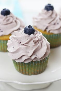 Vanilla Bean Blueberry Cream Cupcakes recipe creates moist and tender homemade cupcakes with a fluffy blueberry whipped cream frosting.