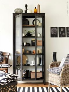 The HEMNES glass-door cabinet displays and protects your collectables at the same time. The bottom shelf is removable, so you can hide cables and cords. Clever!