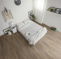 Here, the minimalist bedroom furniture is the wooden headboard that doubles as the desk. Wooden Bedside Table, Wooden Bed Frames, Real Wood Floors, Wood Tile Floors, Minimalist Room, Minimalist Interior, Bedroom Turquoise, Engineered Hardwood Flooring, Custom Home Designs