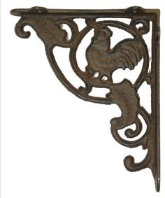 "Rust Cast Iron Rooster Shelf Bracket by IWGA. $23.99. Rust Cast Iron Rooster Shelf Bracket. Rust Cast Iron Rooster Shelf Bracket - Great country decor. Measures 7 1/2"" x 9 1/4""."