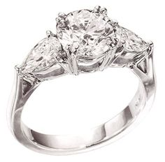 $5,988 Stone Cut : Round brilliant & Pear Stone Specifications: There is one diamond in center of approx. 1.51 carats(approx. diameter 7.3 mm) & 2 diamonds in sides of approx. 0.35 carats each . Natural earth mined diamonds. Total Stone Weight : approx. 2.21 carats Stone Certificate: Comes with free STONE CERTIFICATE from GSL Color : F Clarity : VS1