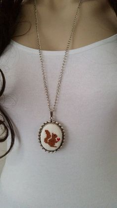 This cross stitch necklace is made of cotton thread,linen fabric,silver plated chain and silver plated apparatus, You can wear the cross stitch