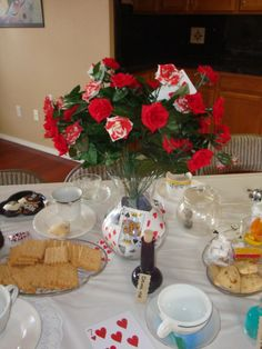 Mad Hatter Tea Party Ideas. Love the vase with the playing cards. Very cute and easy!