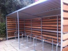 Grasmere Timber Cycle Shelter installed at Tune Hotel Group in London Cycle Storage, Bike Storage, Cycle Shelters, Bike Shelter, Park Signage, Shelter Design, Timber Cladding, Interactive Design, Steel Frame
