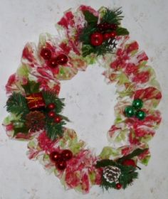Aromaic Christmas Wreath!!   Hand brushed with colored soywax and the essential oil (The Smell of Christmas). Light weight and Gorgeous. Hangs on a tea cup hook. 32 inches around.   .$25.00