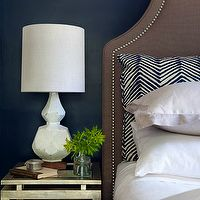 Lauren Nelson Design - bedrooms - navy, blue, walls, antique, mirrored, nightstand, brown, linen, headboard, nailhead trim, brown and blue bedroom, navy blue walls, dark blue walls, dark blue bedroom walls, brown headboard, studded headboard, Quadrille Fabrics Alan Campbell Zig Zag Navy on Tint, West Elm Terracotta Table Lamp,