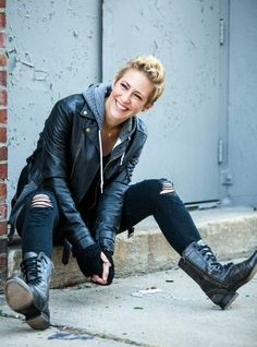 All this. That leather, those gloves, the sweater, that smile, the hair, ripped pants, and, quintessentially, the boots.
