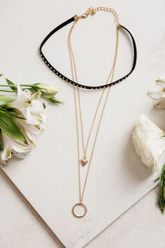 - Description - Details - Keep your jewelry fun and eclectic with the Choker Necklace! A 3 tier choker necklace with a black studded band and two gold necklaces attached. - gold chain link - lobster s