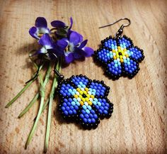Flowers earring ,seed bead earrings, beaded earrings, beaded jewelry, delica seed beadsboho earrings, beadwork jewelry, beadwoven by MouseWorkshopJewerly on Etsy https://www.etsy.com/listing/287693431/flowers-earring-seed-bead-earrings