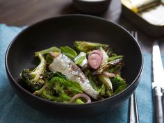 A simple salad: charred broccoli with sardines, pickled shallot, and mint.