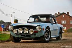 1973 Triumph TR6.  Like the bumperless look and all the driving lights too.