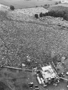 a close up of a road: In this August 1969 file aerial photo, music fans at the original Woodstock Music and Arts Festival are packed around the stage, at bottom, in Bethel. 1969 Woodstock, Woodstock Hippies, Woodstock Festival, Woodstock Music, Old Photos, Vintage Photos, Iconic Photos, Creedence Clearwater Revival, Janis Joplin