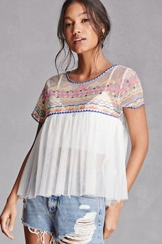 A sheer mesh top featuring an embroidered bodice design, a round neck with a back buttoned keyhole closure, short sleeves, and a babydoll silhouette.  This is an independent brand and not a Forever 21 branded item.