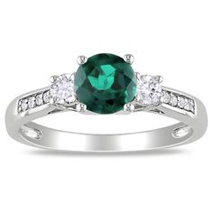 6.0mm Lab-Created Emerald and White Sapphire Three Stone Ring in 10K White Gold with Diamond Accents - Zales, $279. Emerald is May's birthstone, as well as being traditional for preserving love. (Favorite. thx.)