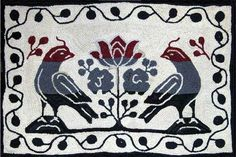 This rug was hooked by Crystal Brown.  I love her rugs - she always has her own creative twist on a design.