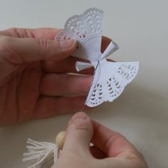 How to Make a Paper Doily Angel & Garland @ArtMind: The other day I was looking at the pile of paper doilies and thought I could make some fun angels from them & string some doilies on a nylon thread to put in front of our window. A bit of holiday decoration without it being too traditional.  Here is what you need: paper doilies, a wooden bead, cotton thread, thin metal thread, scissors, doublesided tape and nylon thread...