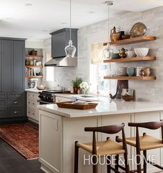 In this galley kitchen, limiting uppers to only one side of the space helps natural light pour in. | Design: Sarah Keenleyside & Lindsay Konior of Quanūk Interiors Photo: Donna Griffith