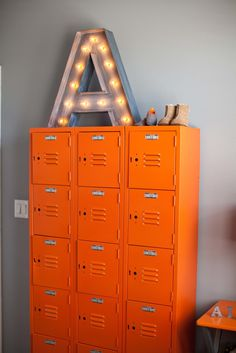 "Couldn't agree more! ""Refurbished Vintage Lockers Painted Orange - such amazing, yet functional storage for the nursery!"" #lockers #lockersinthehome #storage"