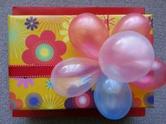 Water balloons as a gift topper♥ Water Balloons, Giving, Fun Ideas, Birthday Cakes, Easter Eggs, Gifts, Presents, Birthday Cake, Favors